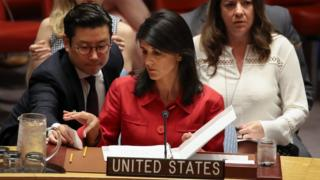 Nikki Haley, United States ambassador to the United Nations, receives a note from an aide during an emergency meeting of the U.N. Security Council at United Nations headquarters, July 5, 2017 in New York City