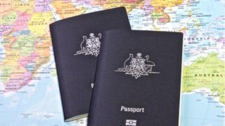 Two Australian passports on a world map