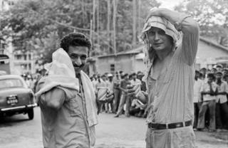 Naseeruddin Shah (left) and Stellan Skarsgard smiling on the sets of a film