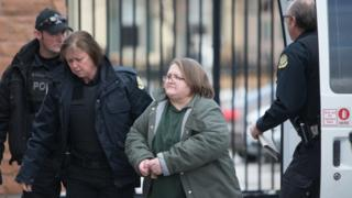 Elizabeth Wettlaufer being escorted into the Woodstock courthouse in January