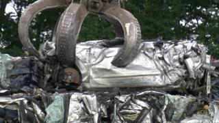 Car being crushed