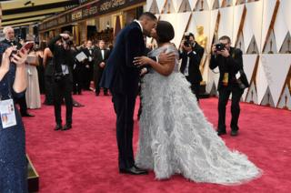 Michael Strahan, left, and Octavia Spencer embrace