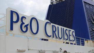 A sign saying P&O Cruises, the operator of Pacific Dawn