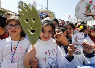 "Tunisian children holding flowers at an event called ""Flowers Walk"" in Tunis, the capital of Tunisia."