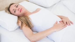 Unwell woman in bed