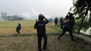 Bangladeshi police officials take part in a raid in Rajshahi on May 11, 2017.