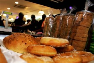 Sales assistants work in the background as breads are displayed in the newly inaugurated Gourmet outlet in Bangalore