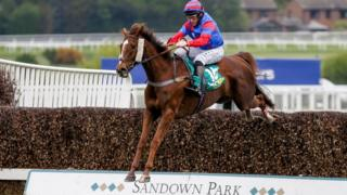 Jamie Moore riding Step Back clear the last to win The bet365 Gold Cup Handicap Steeple Chase at Sandown Park racecourse on April 28, 2018