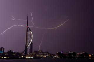Lightning flashes near the Spinnaker Tower in Portsmouth as overnight thunderstorms swept across Britain
