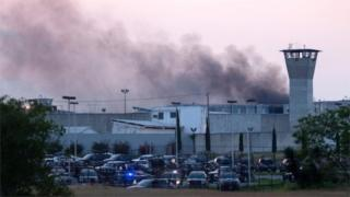 Smoke rises from Cadereyta prison where a brawl left several prisoners wounded on March 27, 2017 in Cadereyta, Nuevo Leon, Mexico.