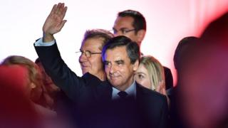 French presidential election candidate for the right-wing Les Republicains (LR) party Francois Fillon waves on March 2, 2017 during a public rally in Nimes,