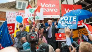 Boris Johnson surrounded by Vote Leave and Vote Remain campaigners