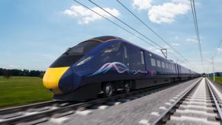 Train speeding along a rail line