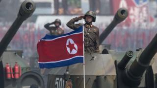 North Korean army tanks conduct a parade