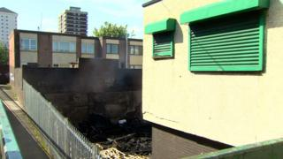 The fire started at the back of a derelict shop, but the intense heat damaged the windows of nearby homes