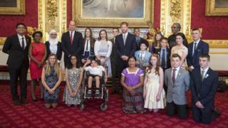 Prince William, Duke of Cambridge and Prince Harry pose with the winners at the Diana Awards at St James' Palace