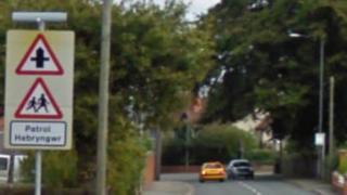 School crossing patrol sign on Ruthin Road near Bryn Coch Lane, Mold