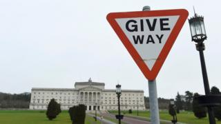A Give Way traffic sign is seen on the road leading to Stormont, the home of Northern Ireland's Assembly