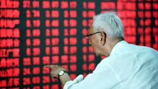 Chinese investor looks at stock board