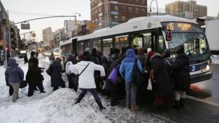 Commuters cram onto a New York City bus