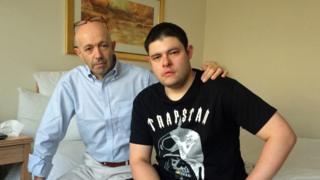 Antonio Rocolato with son Christopher in hotel room