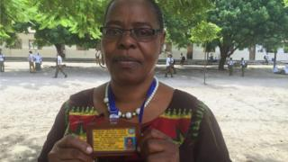 Beatrice Mhina, headmistress at Turiana Secondary School with her ID card for free bus travel.