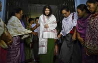 In this Wednesday, Aug. 20, 2014 file photo, Irom Sharmila, center, walks out of a security ward after her release in Porompal district, in Imphal, India. T