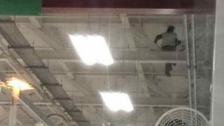 Man in Tesco roof space