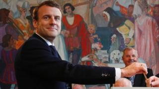 Emmanuel Macron casts his ballot in Le Touquet, northern France