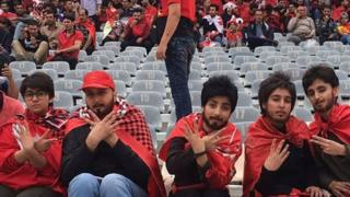 Women disguised as men at the football match