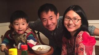Xiyue Wang (centre) with his wife and son (file picture)