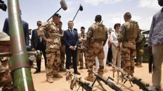 """French President Emmanuel Macron visits French troops in Africa""""s Sahel region in Gao, northern Mali, 19 May 2017"""