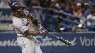 Hanley Ramirez of the Boston Red Sox hits a home run