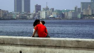 A couple kisses at Havana's seafront on August 3rd, 2006.