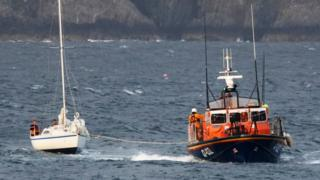 Douglas lifeboat Sir William Hillary with casualty vessel under tow.