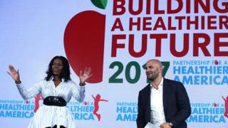 Michelle Obama addresses the Healthier America Summit with former White House chef and Senior Policy Advisor for Nutrition Policy Sam Kass. 12 May 2017