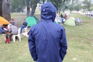 Mohamed, his face hidden