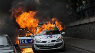 A police car burns after being set on fire during an unauthorized counter-demonstration against police violence on May 18, 2016 in Paris