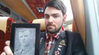 Callan Chevin on his way to the Somme with a photo of his great-great-grandfather's cousin Sergeant Alfred Sanders