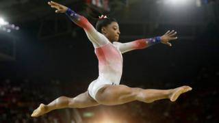 """In this Aug. 17, 2016 file photo, United States"""" Simone Biles performs on the balance beam during the gymnastics exhibition gala at the 2016 Summer Olympics in Rio de Janeiro, Brazil."""