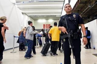 Delayed passengers inside Terminal 7 at the Los Angeles International Airport line up to go through TSA security check following a false alarm event in Los Angeles, California, 28 August