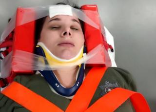 Sam Bailey in a neck brace