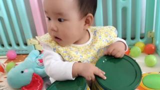 Baby Yiyi cuddles milk formula canisters