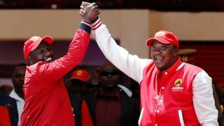 Kenya's President Uhuru Kenyatta (R) and his deputy William Ruto (L) greet as they salute supporters at the Kasarani stadium during the official launch of the Jubilee Party ahead of the 2017 general elections in Kenya's capital Nairobi on 10 September 2016.