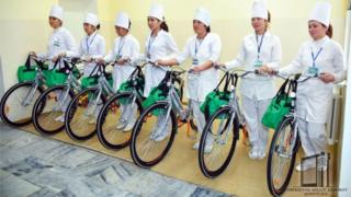 Nurses showing off their new bicycles