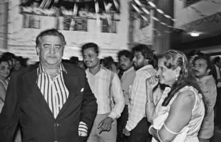 Actor Raj Kapoor at the premiere of Janbaaz while a fan gazes at him