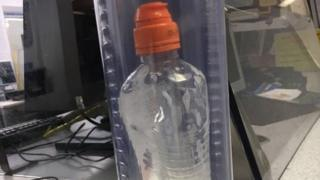 Metropolitan Police undated handout photo of the bottle containing a bleach-like substance that was being carried by Bradley Kerr when he was arrested in Bow Road station in east London