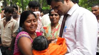 Relatives mourn the death of a child at the Baba Raghav Das Hospital in Gorakhpur, in the northern Indian state of Uttar Pradesh