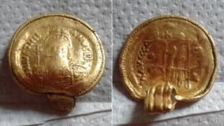 The front and back of the coin