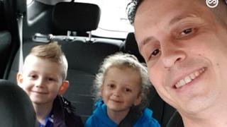 Ian Lloyd with his two children
